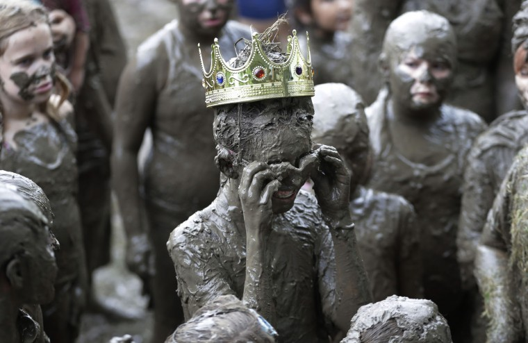Mackenna Kofahl, 12, removes her goggles after being crowned 2017 Queen of Mud Day at the Nankin Mills Park, Tuesday, July 11, 2017 in Westland, Mich. The annual day sponsored by the Wayne County Parks takes place in a 75' x 150' giant mud pit that gives children the opportunity to get down and dirty at one of the messiest playgrounds Southeast Michigan has ever seen. (AP Photo/Carlos Osorio)