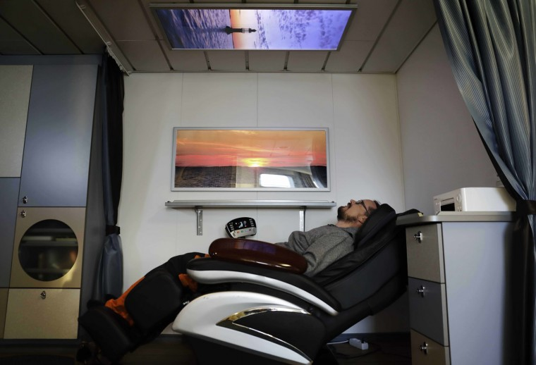 In this Thursday, July 6, 2017 photo, researcher Ari Laakso reclines in a massage chair aboard the Finnish icebreaker MSV Nordica as it sails the North Pacific Ocean to traverse the Northwest Passage through the Canadian Arctic Archipelago. (AP Photo/David Goldman)