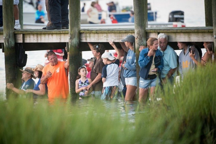 "Attendees wait in anticipation for ponies and horses to begin swimming from Assateague Island to Chincoteague Island, Va., during ""slack tide"" at the 92nd Annual Chincoteague Pony Swim on Wednesday, July 26, 2017. (Michael Ares / The Baltimore Sun)"