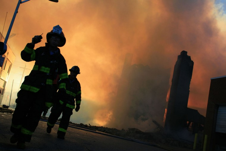 """Baltimore firefighters struggle to put out a three-alarm fire at a warehouse near Kirk Avenue and Curtain Avenue in November 2014."" (Photo and caption courtesy of Maggie Ybarra)"