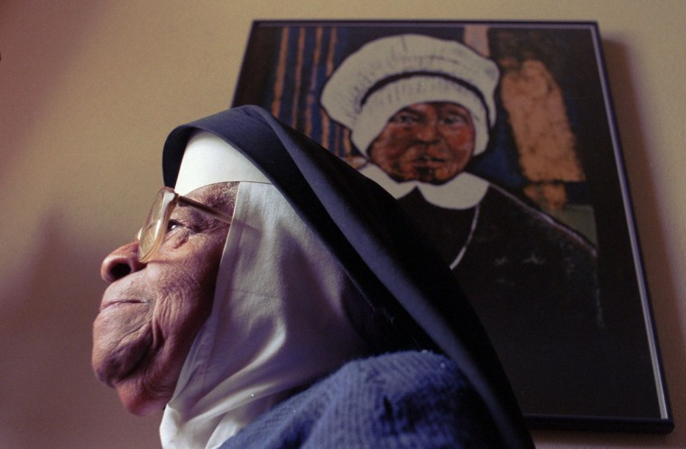 Sister Mary Callista, 92 years old, has been with the Oblate Sisters of Providence for 75 years. Behind her is a painting of Sister Mary Elizabeth Lange, foundress of the world's first order of nuns of African heritage. The Catholic order was founded in Baltimore in 1829, with the mission to teach children of color. This is my favorite picture because of Sister Callista's expression which reveals so many things: strength, peace, contentment, faith. I like the painting of the foundress in the background not only because she appears to be looking upon one of her successors approvingly, but also because the painting conveys the passage of time and the passing of a legacy of religious service from generation to generation. (Algerina Perna/Baltimore Sun)