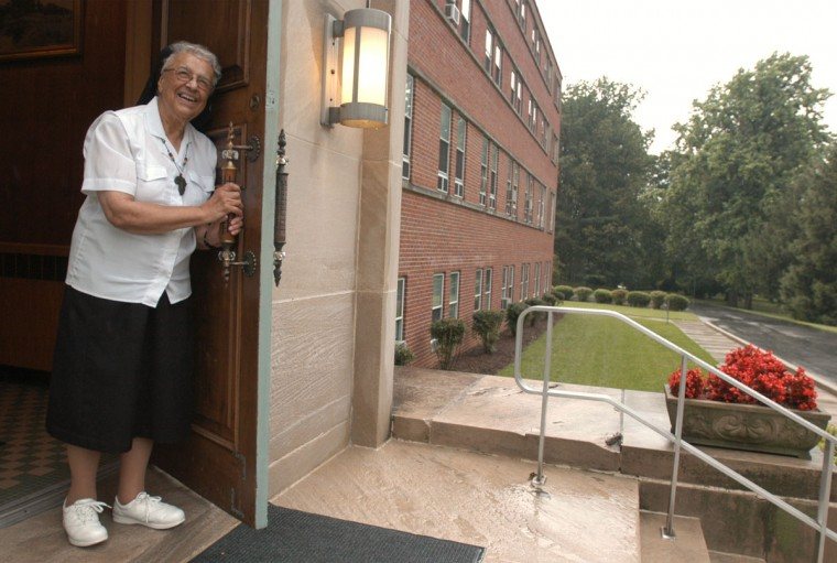 Catonsville, MD--June 25, 2004- Oblate Sisters of Providence will be celebrating their order's 175th anniversary next week. Here, Sister Mary Alice Chineworth, who has been a nun for 68 years, looks out the convent's front door. (Barbara Haddock Taylor/Baltimore Sun)