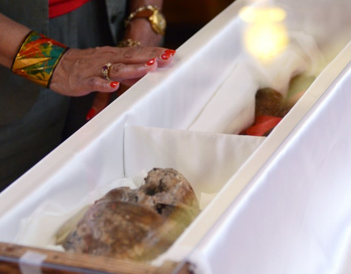 A woman attending the transfer of remains for Mother Mary Lange touches the casing holding those remains. Monday, June 3, 2013 at Oblate Sisters of Providence in Arbutus. (Baltimore Sun archives)
