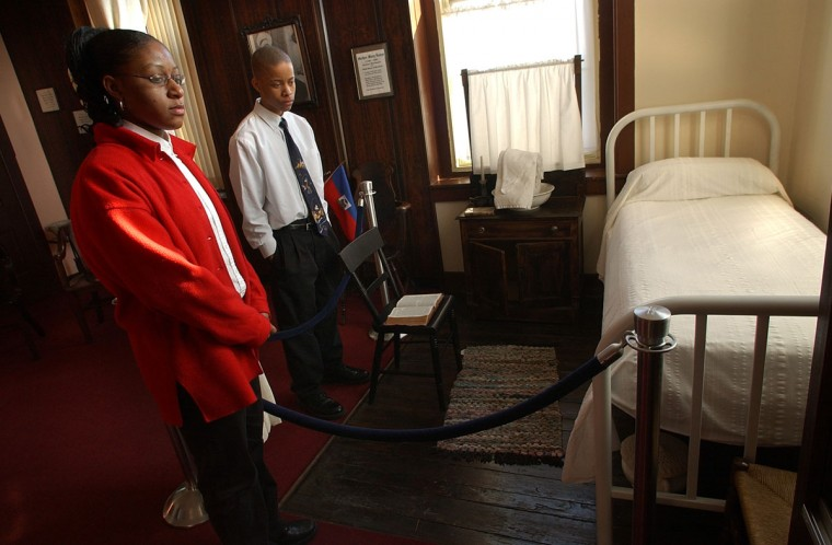 BALTIMORE,MD -- 2/1/05: St. Frances Academy students Brandi Vaughan, left, and Brandon Wells look over the room where Mother Lange actually slept when teaching at the school. (JED KIRSCHBAUM/BALTIMORE SUN)