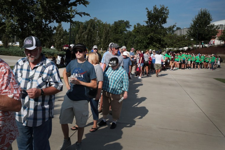 People wait for the gates to open at Saluki Stadium on the campus of Southern Illinois University to watch the solar eclipse on August 21, 2017 in Carbondale, Illinois. With approximately 2 minutes 40 seconds of totality the area in Southern Illinois will experience the longest duration of totality during the eclipse. Millions of people are expected to watch as the eclipse cuts a path of totality 70 miles wide across the United States from Oregon to South Carolina on August 21. (Photo by Scott Olson/Getty Images)