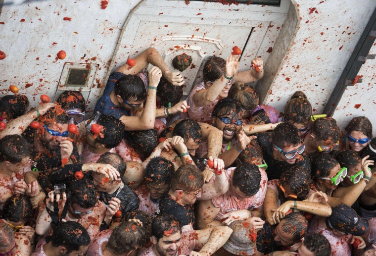 "Revellers covered in tomato pulp participate in the annual ""Tomatina"" festival in the eastern town of Bunol, on August 30, 2017. The iconic fiesta -- which celebrates its 72nd anniversary and is billed at ""the world's biggest food fight"" -- has become a major draw for foreigners, in particular from Britain, Japan and the United States. (JAIME REINA/AFP/Getty Images)"