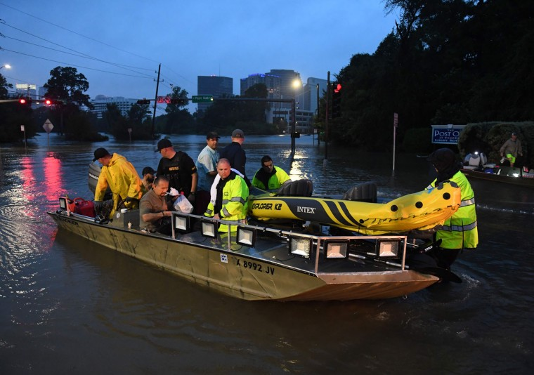 People are rescued from a hotel by boat after Hurricane Harvey caused heavy flooding in Houston, Texas on August 27, 2017. Massive flooding unleashed by deadly monster storm Harvey left Houston -- the fourth-largest city in the United States -- increasingly isolated as its airports and highways shut down and residents fled homes waist-deep in water. (Mark Ralston/AFP/Getty Images)