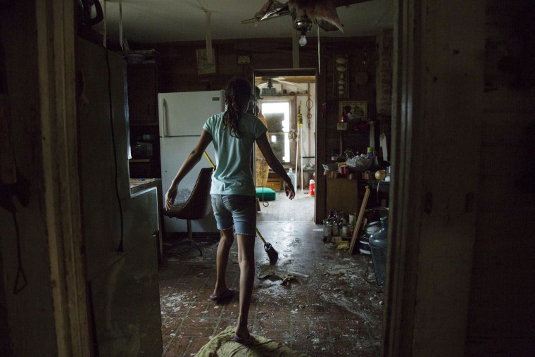 Laela Carpenter walks through her home on Sunday, Aug. 27, 2017, in Bayside, Texas which was hit by Hurricane Harvey. (Olivia Vanni/The Victoria Advocate via AP)