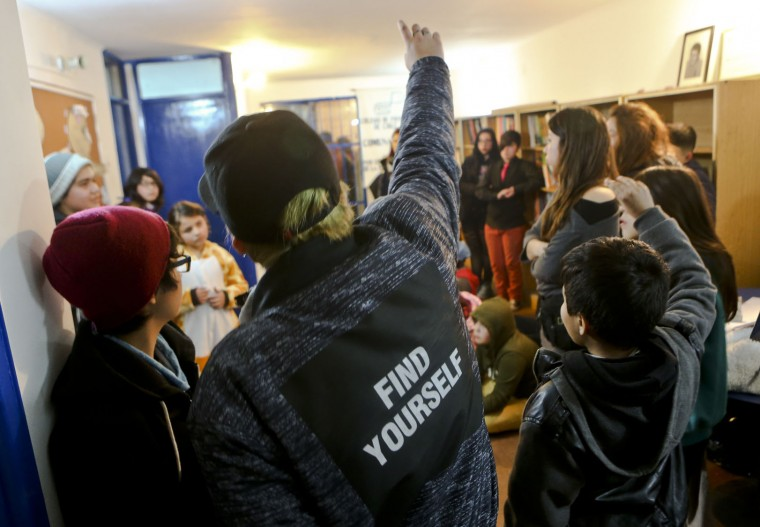 In this July 22, 2017 photo, transgender children attend a workshop on gender identity at a community center in Santiago, Chile. The Education Ministry issued a directive in May urging schools nationwide to protect the sexual orientation and gender identity of student, while the country's Catholic schools association has promised to resist the measure. (AP Photo/Esteban Felix)