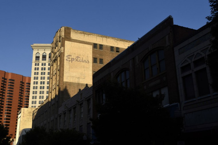 Ghost signs of two department stores, Julius Gutman which later became Epstein's, on W. Lexington St. are seen from N. Howard St. (Kim Hairston/Baltimore Sun)