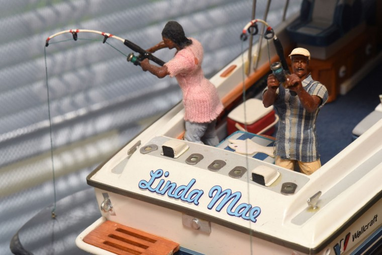 "Norman Gross modified toy action figures to represent himself and his wife fishing on their boat, the ""Linda Mae,"" which is named after her. Gross gave up the boat when he moved to Edgewater last year, but admits that he still misses it. (Amy Davis / The Baltimore Sun)"