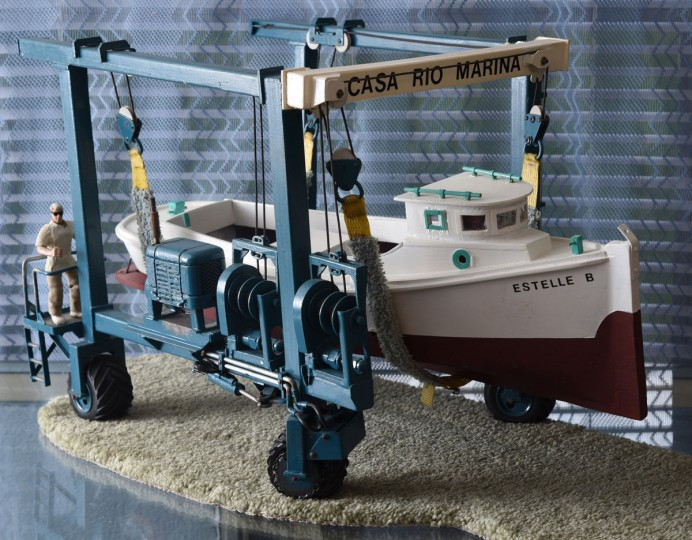 "A model of the ""Estelle B"" is supported on a replica travel lift from the Casa Rio Marina, where Norman Gross worked off and on in the 1980s and early 1990s. He learned the craft of fiberglass work at this marina in Mayo. Norman Gross, 58, builds model boats that pay homage to an earlier generation of African-American watermen on the Chesapeake. (Amy Davis / The Baltimore Sun)"