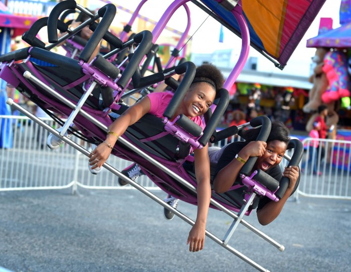 Kyja Wilson, 12 and Kayla Briggs, 12 of Baltimore on the Cliff Hanger ride. 136th unforgettable My Maryland State Fair begins with a Ridemania night on Thursday. (Lloyd Fox/Baltimore Sun)