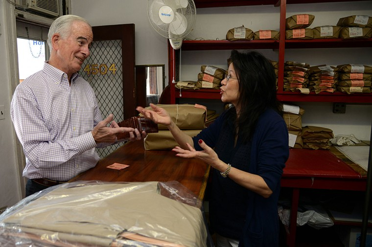 Bill Patternotte of Baltimore, left, whose family have been customers at T.C. Wing Laundry for 5 generations, talks with Shirley Tsao, right, whose grandfather-in-law founded the family business in 1932.
