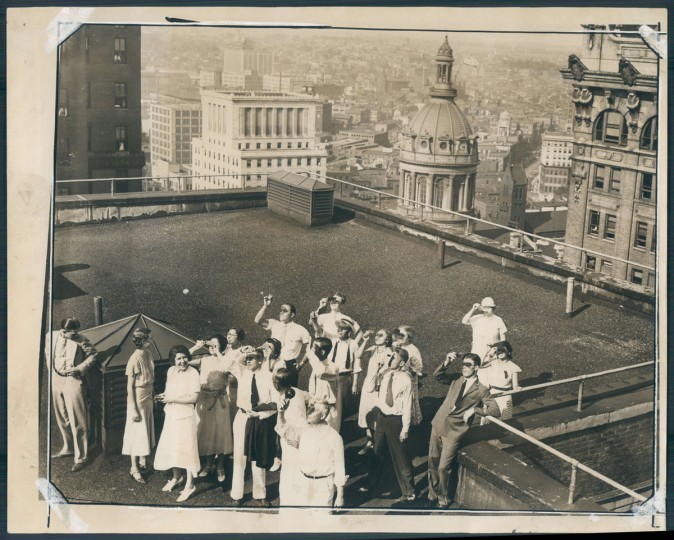 Office workers view a solar eclipse from the roof of the Continental Building on August 31, 1932. (Baltimore Sun archives)