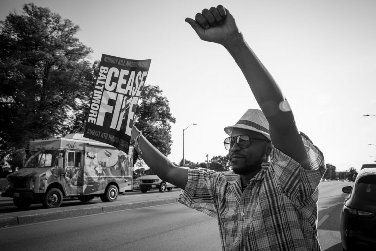 "Baltimore, MD -- 8/4/2017 -- Christopher ""Bangla"" Keene from Baltimore. Day 1 of the 72 hours Baltimore Ceasefire. ""Stop the Violence Rally"" located on Edmondson Avenue and Wildwood Parkway, where approximately 75 local Baltimore city residents came out to promo the Ceasefire message. (Photo and caption by Paul Lai)"