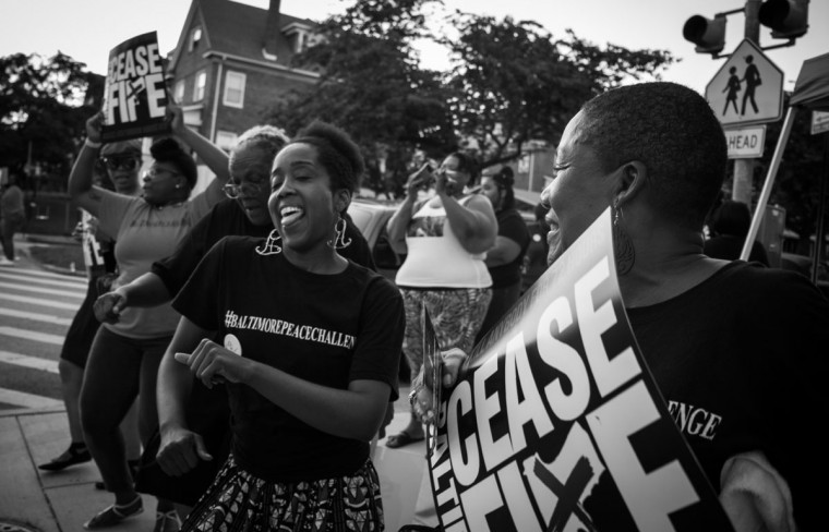 "Baltimore, MD -- 8/4/2017 -- Rally supporters dancing to the tunes from the DJ. Day 1 of the 72 hours Baltimore Ceasefire. ""Stop the Violence Rally"" located on Edmondson Avenue and Wildwood Parkway, where approximately 75 local Baltimore city residents came out to promo the Ceasefire message. (Photo and caption by Paul Lai)"