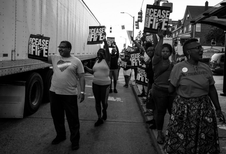 "Baltimore, MD -- 8/4/2017 -- Rally supporters standing on the street promoting Ceasefire message to on coming traffics. Day 1 of the 72 hours Baltimore Ceasefire. ""Stop the Violence Rally"" located on Edmondson Avenue and Wildwood Parkway, where approximately 75 local Baltimore city residents came out to promo the Ceasefire message. (Photo and caption by Paul Lai)"