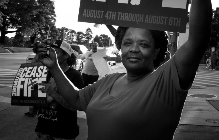 "Baltimore, MD -- 8/4/2017 -- Garcenia Grant from Baltimore holding up Ceasefire sign at the Baltimore Ceasefire ""Stop the Violence Rally"" located on Edmondson Avenue and Wildwood Parkway. Day 1 of the 72 hours Baltimore Ceasefire. ""Stop the Violence Rally"" located on Edmondson Avenue and Wildwood Parkway, where approximately 75 local Baltimore city residents came out to promo the Ceasefire message. (Photo and caption by Paul Lai)"