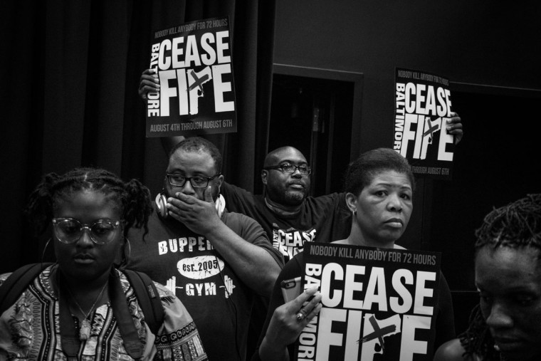Baltimore, MD -- 8/6/2017 -- Participants are solemn immediately after the 211 names are read. Day 3 of the 72 hours Baltimore Ceasefire. A downtown vigil gathered over 100 Ceasefire supporters to read the names of 211 victims of violence in Baltimore city. (Photo and caption by Paul Lai)
