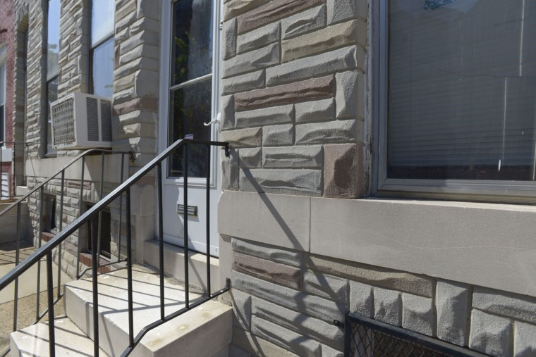 A formstone-clad house on N. Caroline Street in East Baltimore. (Christina Tkacik/Baltimore Sun)