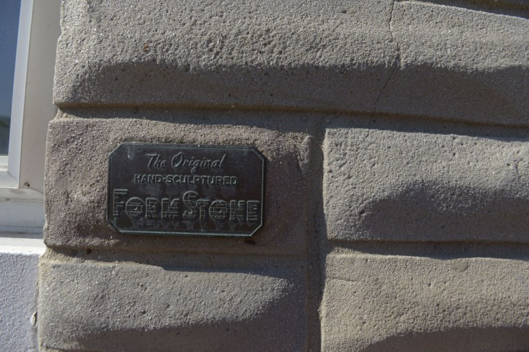 A plaque on the exterior of a home in East Baltimore shows it was installed by FormStone, the most famous of the exterior siding companies. (Christina Tkacik/Baltimore Sun)