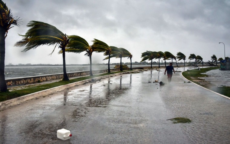 A man walks against heavy winds after the passage of Hurricane Irma, at Caibarien, Villa Clara province, 330km east of Havana, on September 9, 2017. Irma's blast through the Cuban coastline weakened the storm to a Category Three, but it is still packing 125 mile-an-hour winds (205 kilometer per hour) and was expected to regain power before hitting the Florida Keys early Sunday, US forecasters said. The Cuban government extended its maximum state of alert to three additional provinces, including Havana, amid fears of flooding in low-lying areas. (Alberto Roque/AFP/Getty Images)