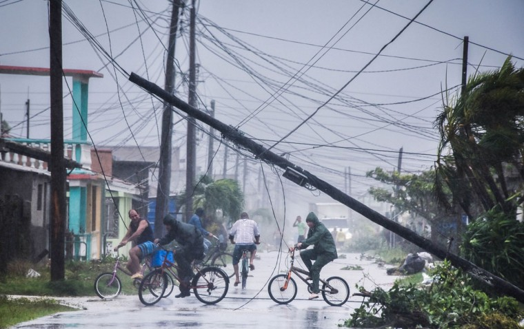 Local residents return home after the passage of Hurricane Irma in Caibarien, Villa Clara province, 330km east of Havana, on September 9, 2017. Irma's blast through the Cuban coastline weakened the storm to a Category Three, but it is still packing 125 mile-an-hour winds (205 kilometer per hour) and was expected to regain power before hitting the Florida Keys early Sunday, US forecasters said. The Cuban government extended its maximum state of alert to three additional provinces, including Havana, amid fears of flooding in low-lying areas. (Alberto Roque/AFP/Getty Images)