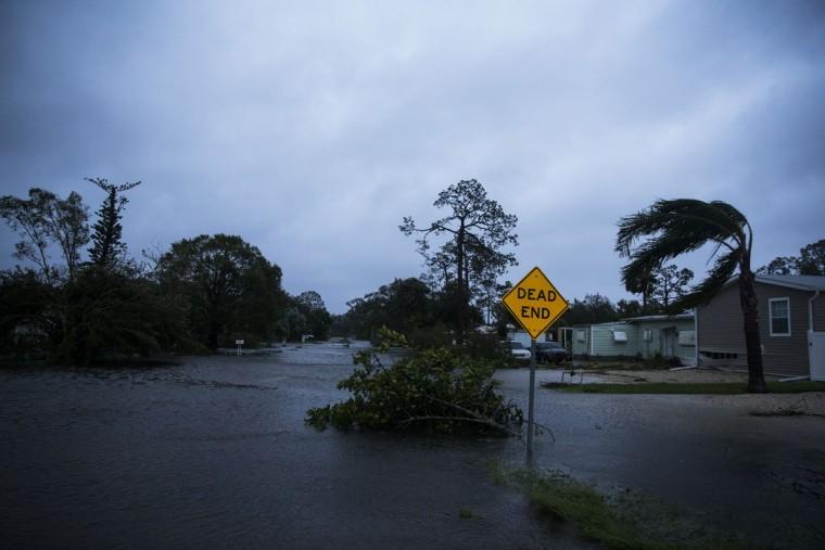 Floodwater fills Meadow Lane in Bonita Springs, Fla., Sunday, Sept. 10, 2017, as Hurricane Irma passes. (Nicole Raucheisen/Naples Daily News via AP)