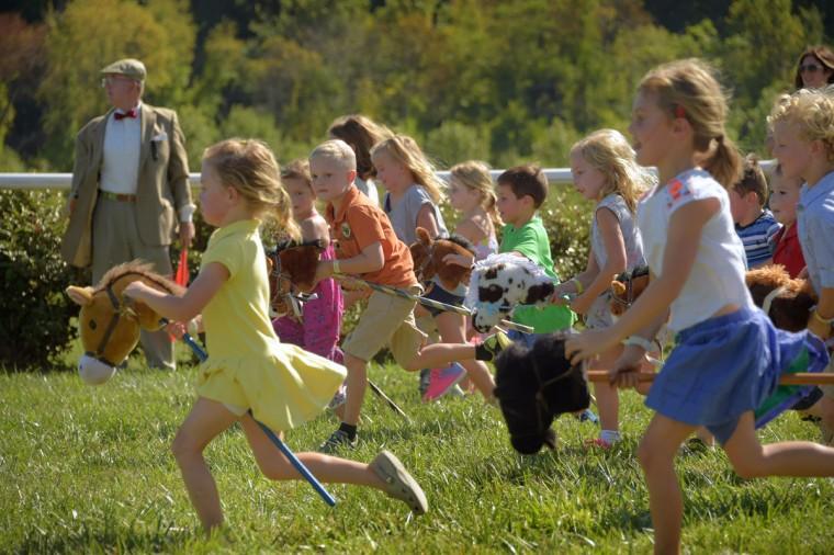 Kindergarten-aged children start off in their stick horse heat during the 2017 Legacy Chase at Shawan Downs. (Karl Merton Ferron / Baltimore Sun Staff)
