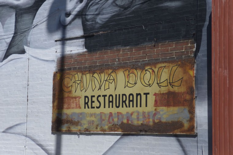 Dilapidated signs for the China Doll restaurant are all that remain of this Chinese restaurant on Park Avenue, once the heart of Baltimore's Chinese community. (Christina Tkacik/Baltimore Sun)