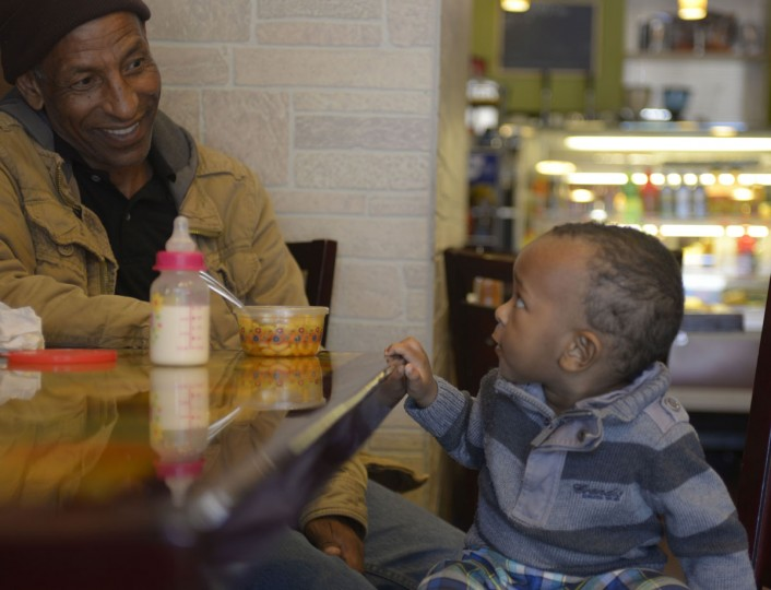 Musa Ahmed and Salim Beshir enjoy a chat and an early lunch at an Ethiopian-run cafe on Park Avenue. Once a predominantly Chinese block, the area is now home to a growing Ethiopian community. (Christina Tkacik/Baltimore Sun)