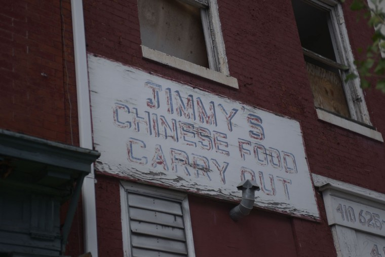 A scratched-up sign for Jimmy's Chinese Carry Out is all that remains of this Chinese restaurant on Park Avenue, once the heart of Baltimore's Chinese community. (Christina Tkacik/Baltimore Sun)