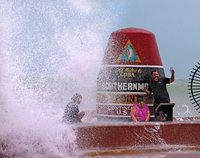 Key West resident Pedro Lara takes selfie in front of the Southernmost Point in the USA monument as waves from Hurrican Irma crash over the wall on Saturday, Sept. 9, 2017. Some residents refused to evacuate as Hurricane Iram approaches the Florida Keys. (Charles Trainor Jr./Miami Herald/TNS)
