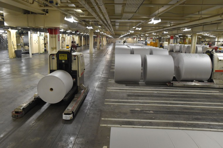 The reelroom houses the rolls of newsprint and the one ton rolls are moved by robotic units called, AGV's. The AGV's move the paper to and from the press. (Lloyd Fox/Baltimore Sun)