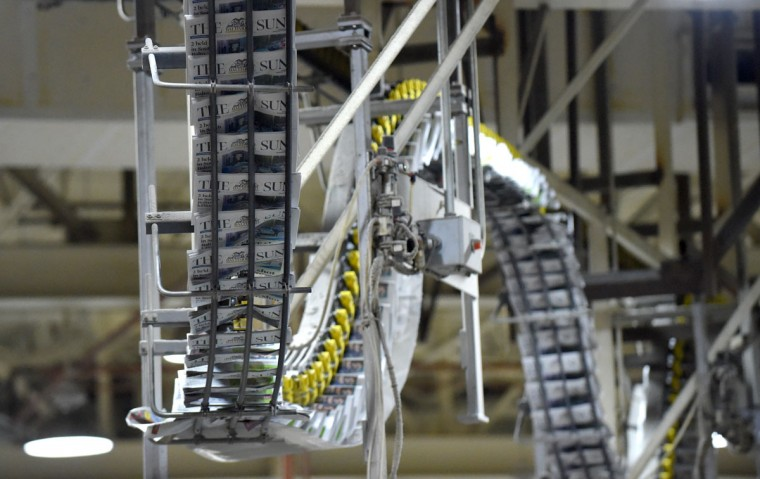Conveyor belts carry the printed papers to the packaging area. (Lloyd Fox/Baltimore Sun)