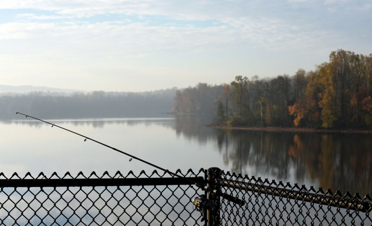 A fisherman set his rod on the fence at Loch Raven Reservoir. (Barbara Haddock Taylor/Baltimore Sun)