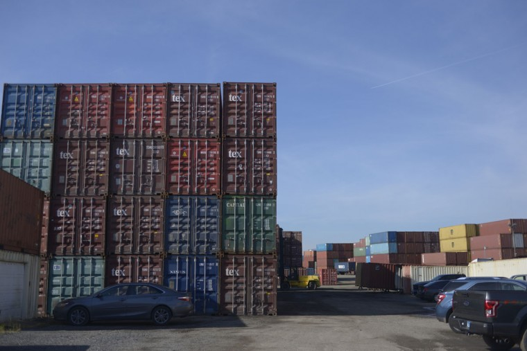 Nearby, stacks of shipping containers are stacked like legos for giants, bearing names of far off destinations. (Christina Tkacik/Baltimore Sun)