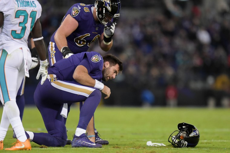 Unfortunately for Flacco, he didn't stay in the game much longer. Late in the 2nd quarter, he slid at the end of a 9-yard scramble and took a forearm to the head on a late hit by the Dolphins' Kiko Alonso. He was slow to get up and once he did, he went straight to the locker room. He was soon ruled out for the rest of the game. (Ulysses Munoz/Baltimore Sun)