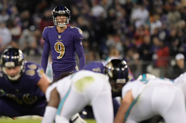 The Ravens' placekicker Justin Tucker looks up at the field goal posts to line up his shot before an attempt to add three more points to his team's score. (Ulysses Munoz/Baltimore Sun)