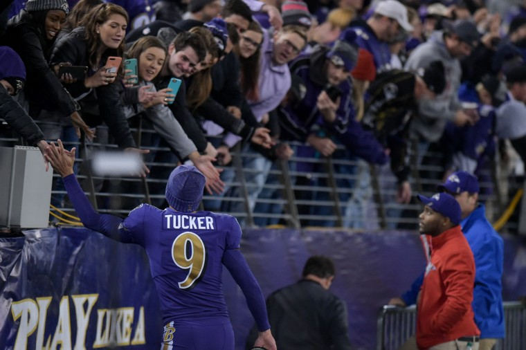 At the end of the 40-0 shutout, the Ravens went back into the locker room via the entrance/exit behind their own bench. Justin Tucker high fives fans on the way down. (Ulysses Munoz/Baltimore Sun)