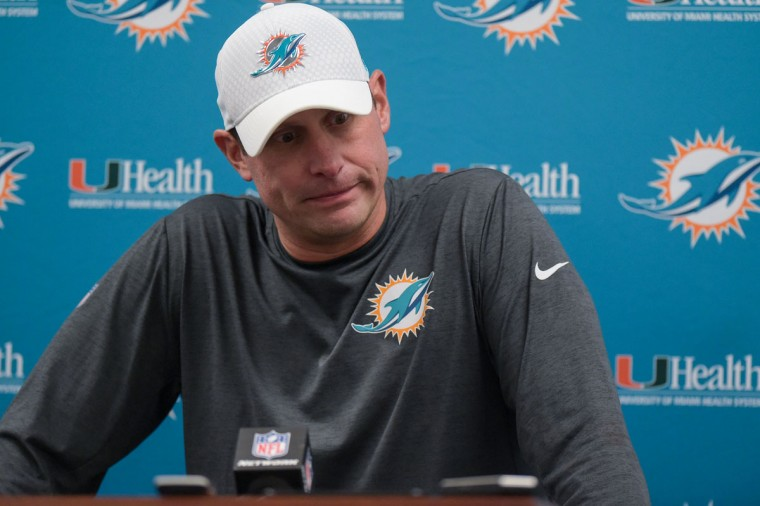 Back in the visiting team's media room, which the photographers also use as a workroom, Dolphins head coach Adam Gase addresses members of the media. (Ulysses Munoz/Baltimore Sun)