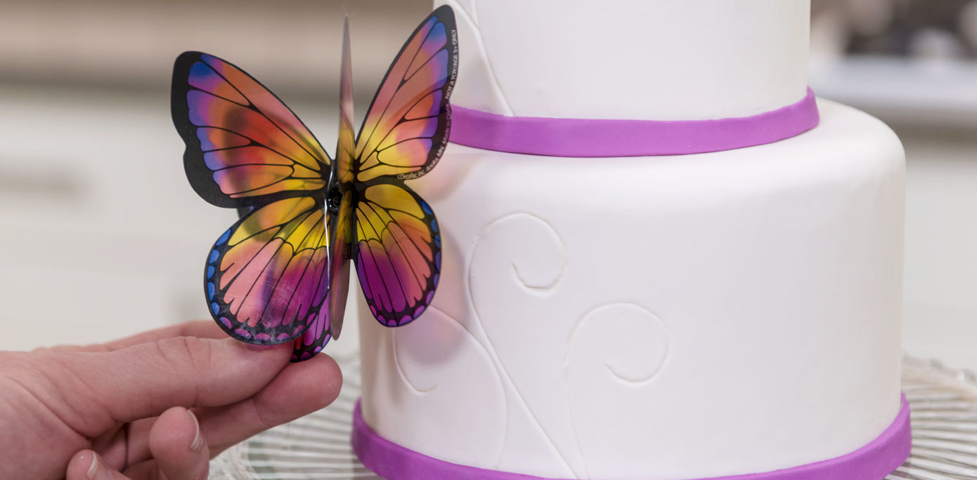 Add a Butterfly layon cake topper to the side of a Mother's Day fondant cake