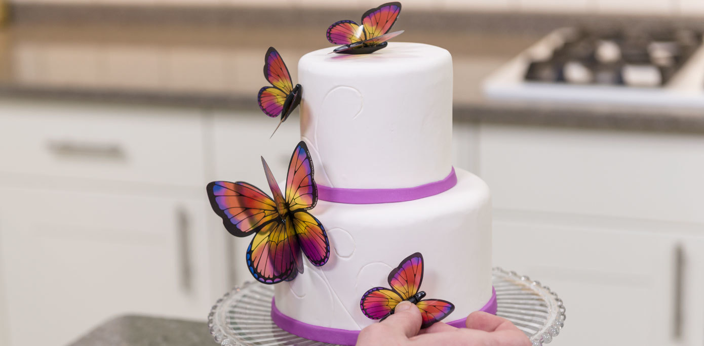 Add butterfly decopics to the sides and top of a Mother's Day butterfly cake