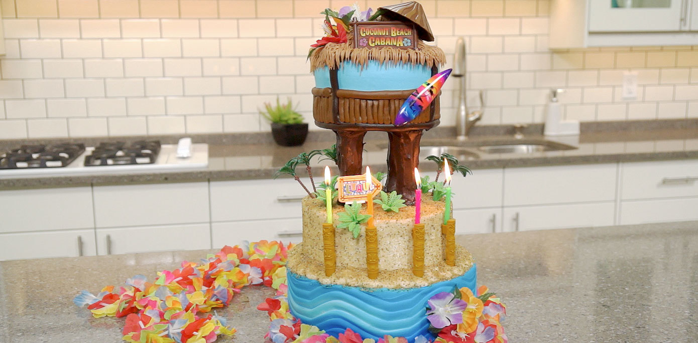 Add tiki hut cake decorations and a lei for complete your cabana cake
