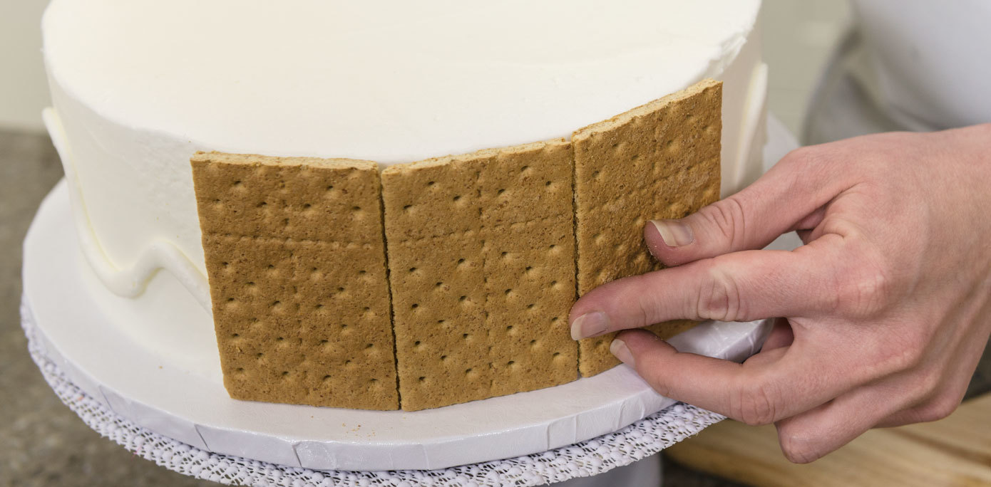Add graham crackers around the sides of a s'mores cake