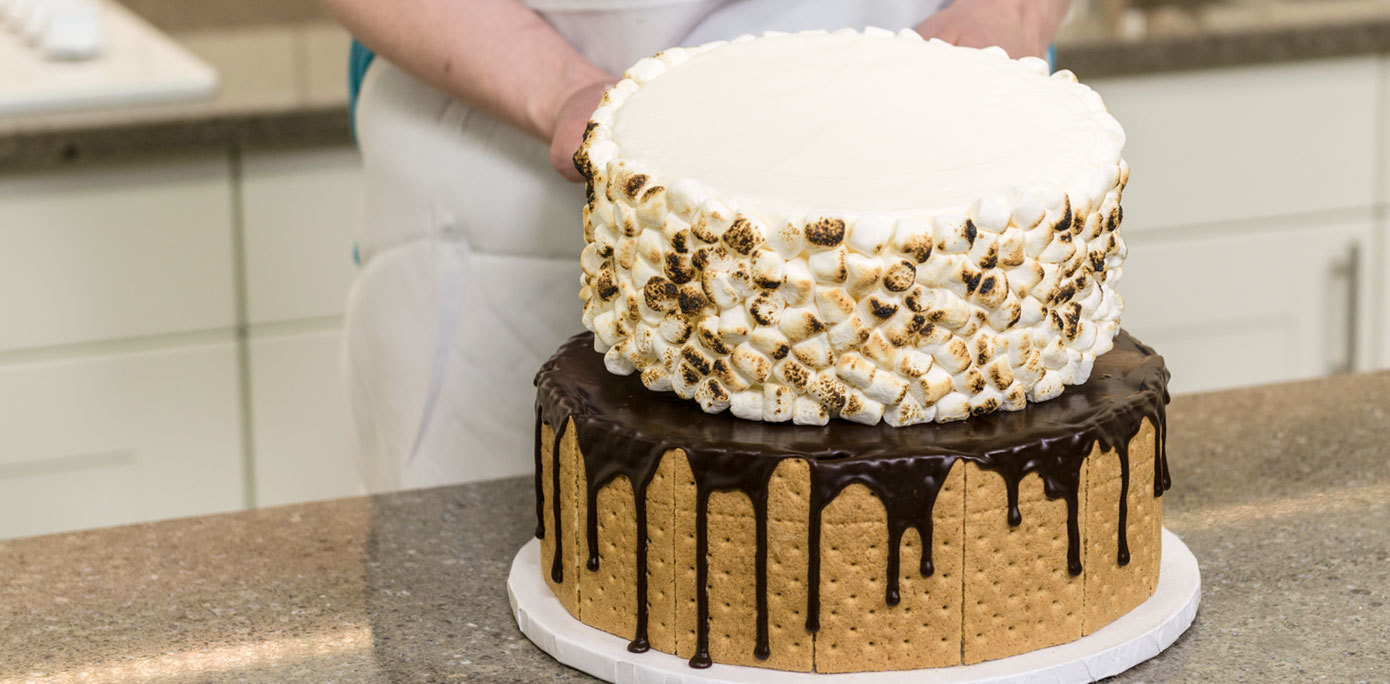 Stack marshmallow and graham cracker cakes together for a 2-tier s'mores cake