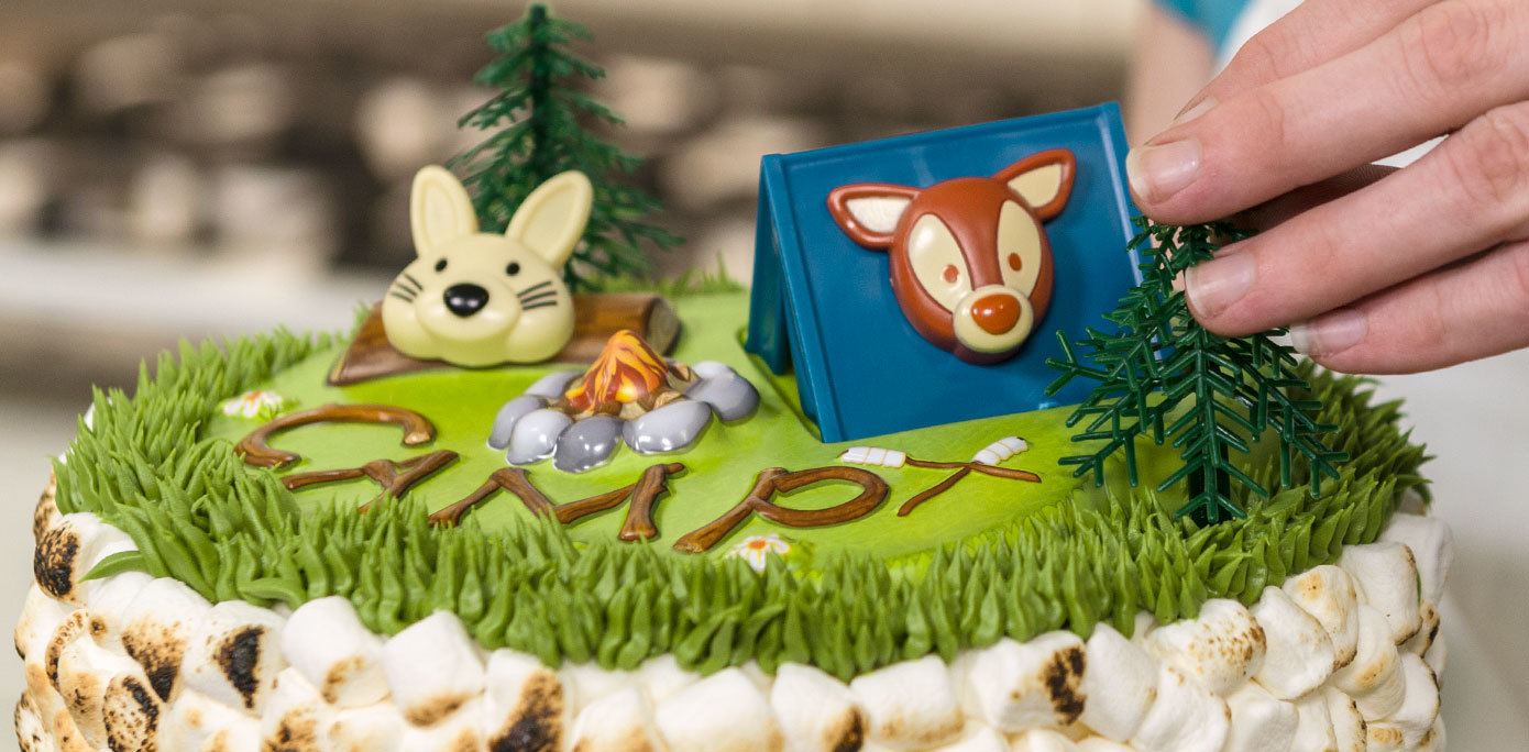 Add camping decorations to your s'mores cake