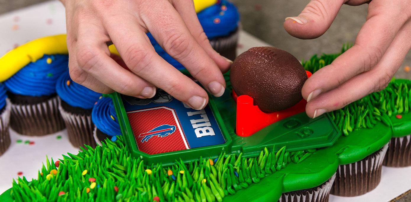 Add NFL DecoSet Cake Topper to a football goal post cupcake cake
