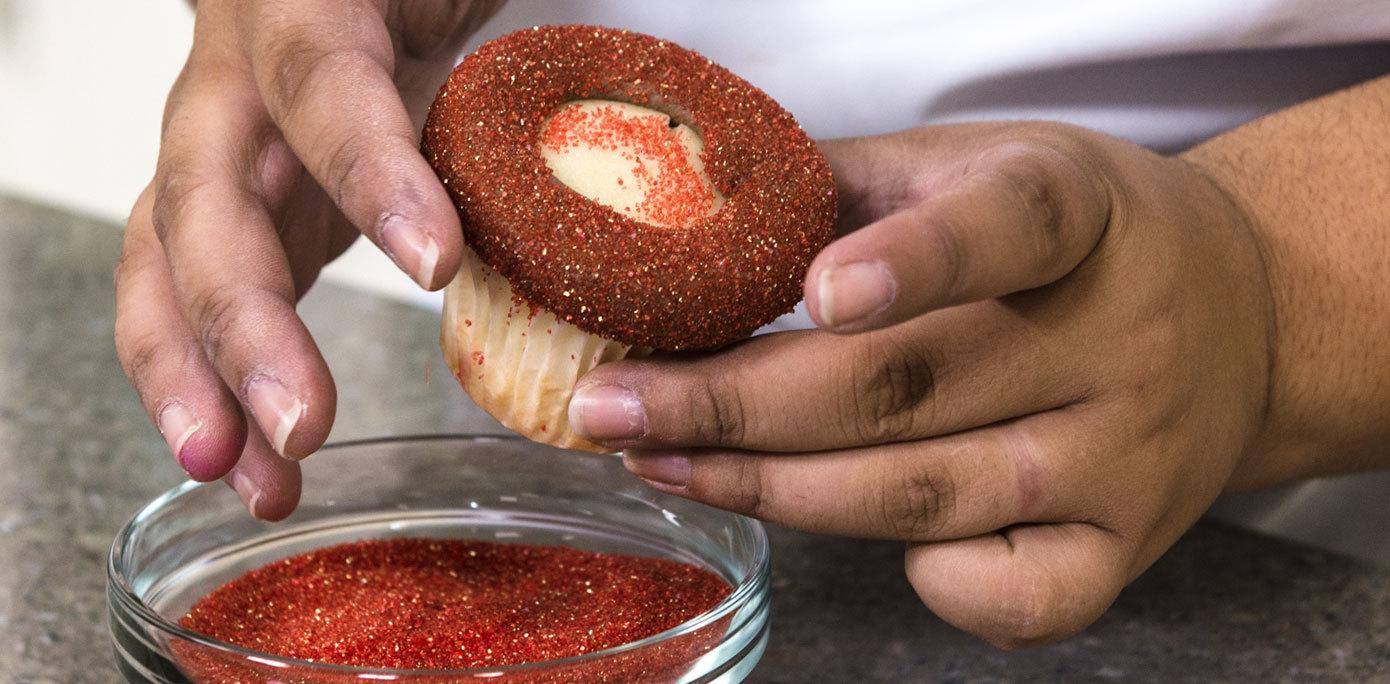 Roll cupcakes in sanding sugar